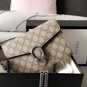 d023dd8ceda Gucci Bags - Dionysus GG Supreme Chain wallet